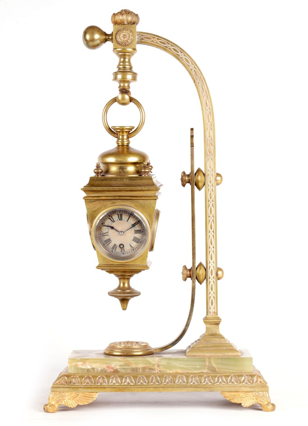 AN UNUSUAL LATE 19TH CENTURY FRENCH BRASS AND ONYX NOVELTY MANTEL CLOCK