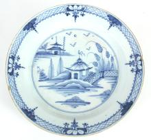 A LATE 18TH CENTURY BLUE AND WHITE DELFT CHARGER WITH CHINES