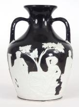 A LATE 19TH CENTURY WEDGEWOOD BLACK JASPER PORTLAND VASE WIT