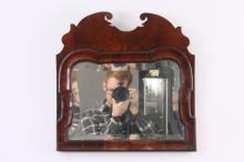 AN EARLY 18TH CENTURY WALNUT QUEEN ANNE HANGING MIRROR WITH