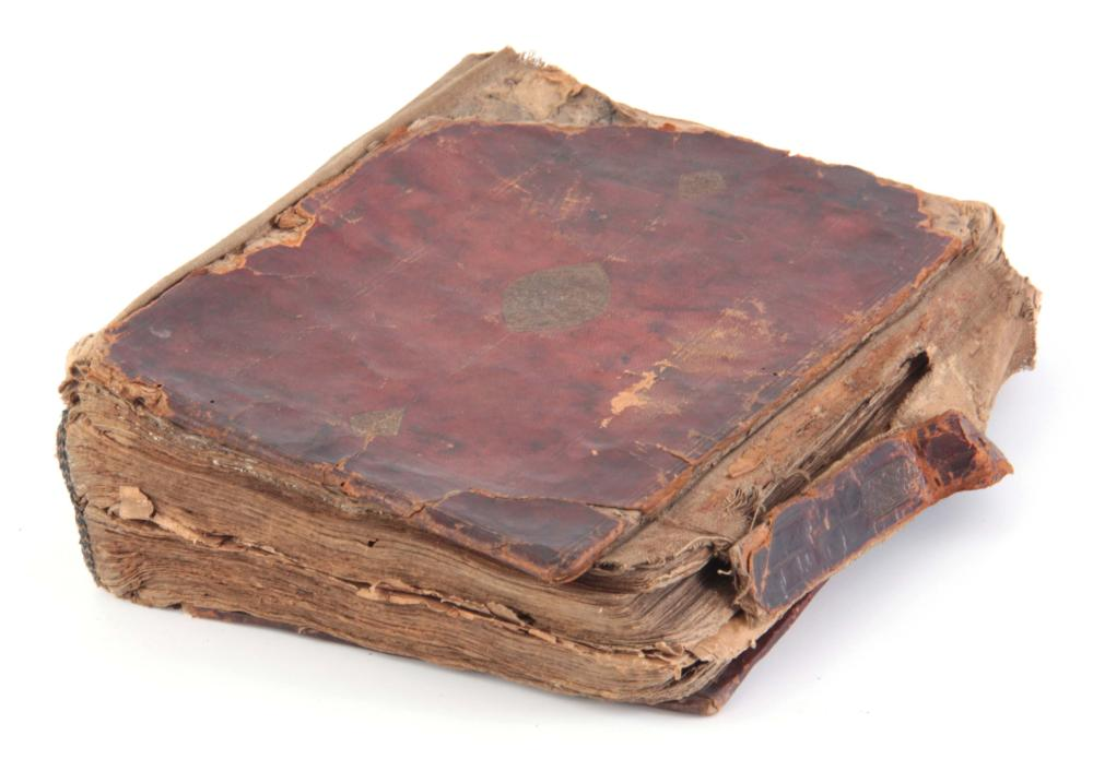 AN EARLY LEATHER BOUND BOOK OF THE QURAN handwritt