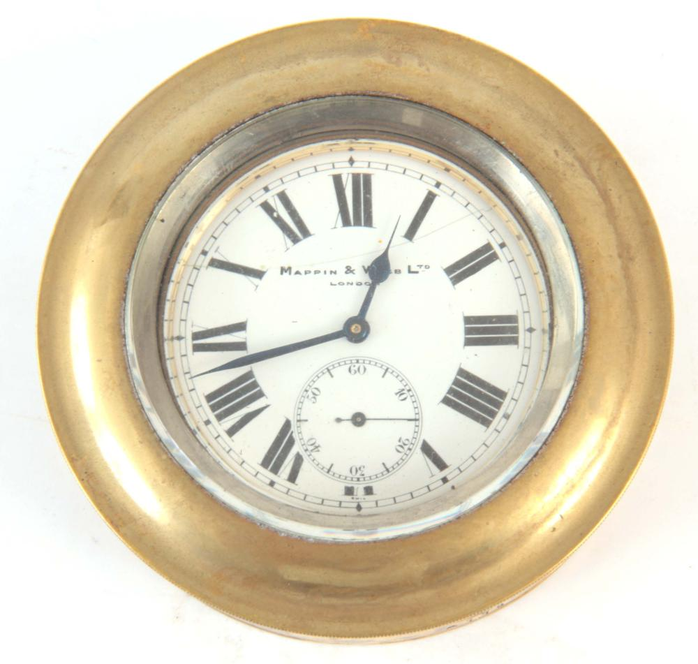 AN EARLY 20th CENTURY BRASS CASED CAR CLOCK with p