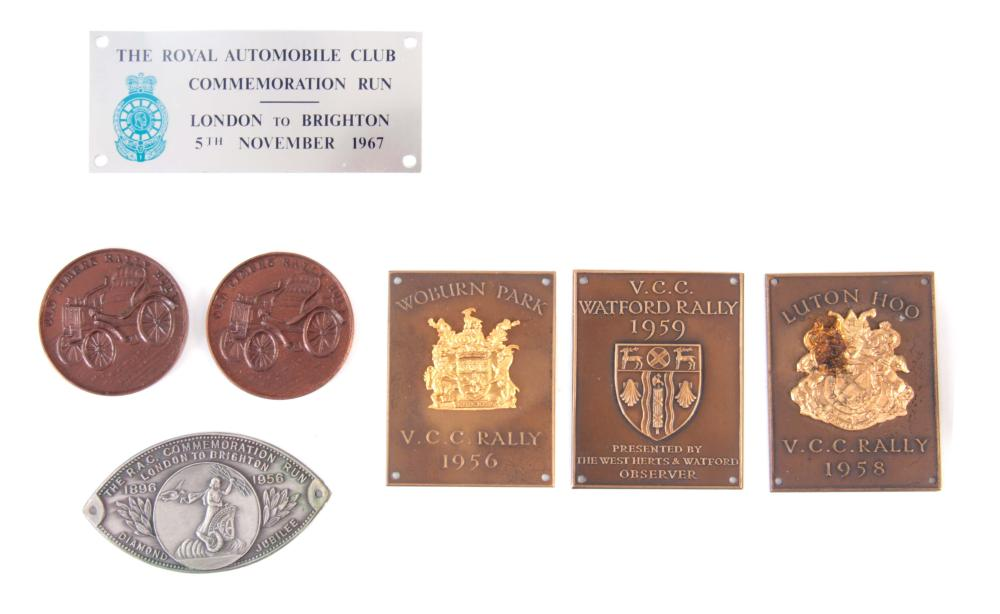 A COLLECTION OF SIX BRONZE V.C.C. RALLY BADGES for