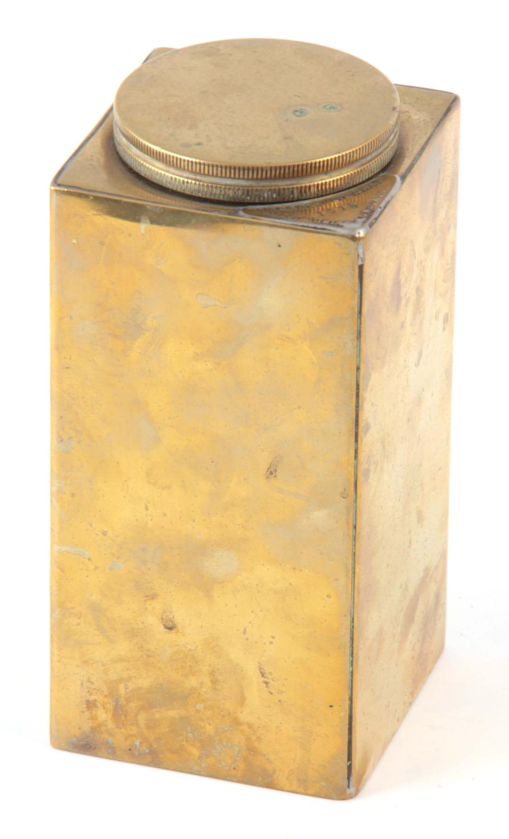 A BRASS OIL CONTAINER WITH NAME BADGE STAMPED 'IMP