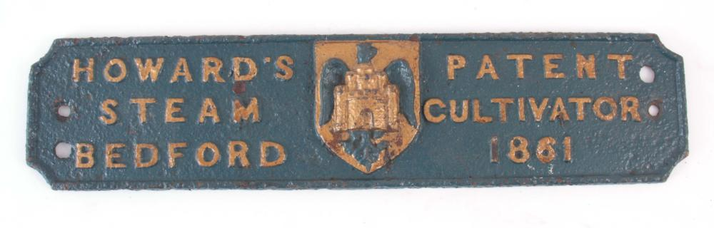 A PAINTED CAST IRON STEAM PLOUGHING PLAQUE for 'HO
