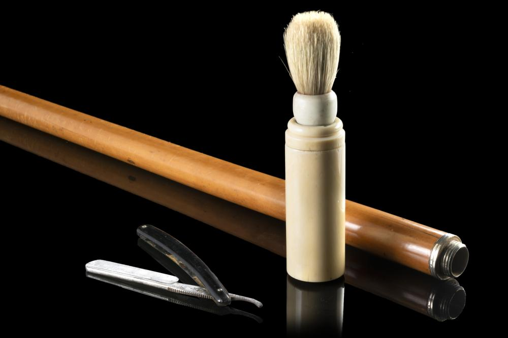 """A malacca toilette stick hiding a shaving set in the ivory handle. Ciphered """"BR"""". Metal toe cap. 19th century (L. cm 90) This lot may be subject to Import/Export restrictions due to CITES regulations in some extra UE countries..."""