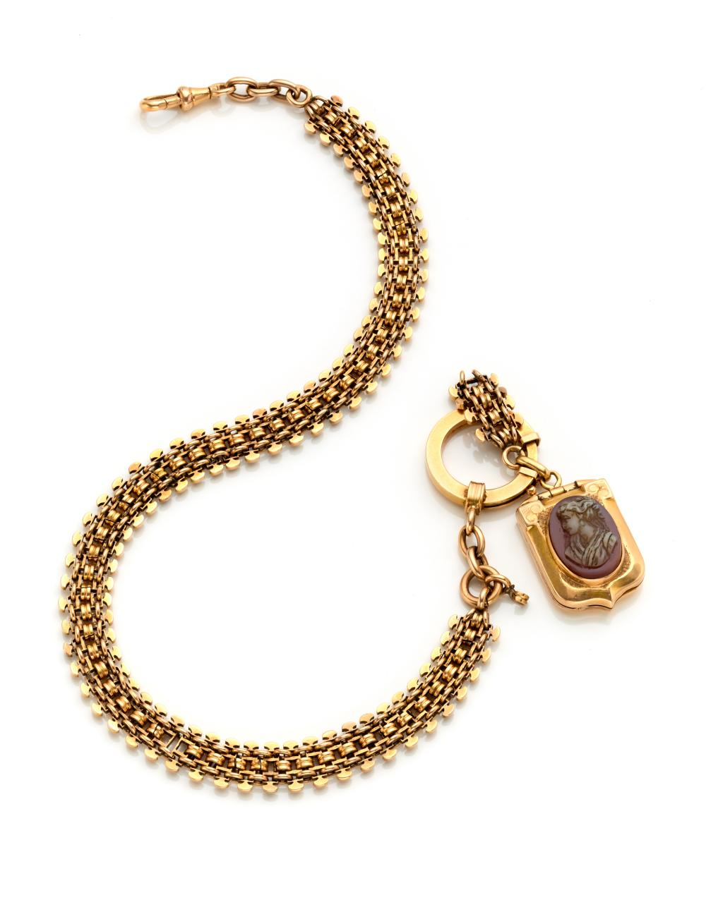 Yellow gold watch chain finished with a carnelian cameo pendant/locket of cm 4.6 circa, g 47.65 circa, length cm 34 circa. (defects and losses)...