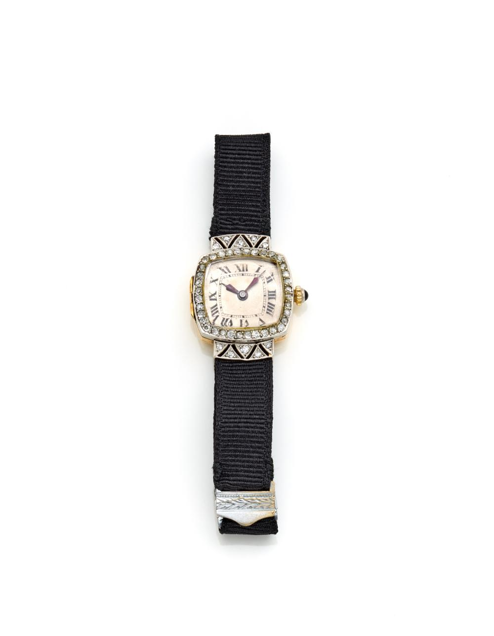 Yellow gold and platinum women's watch with diamonds, onyx on the crown, fabric strap and metal buckle, gross g 10.65 circa, width cm 2.00 circa. Mark n° 813486 inside the case....