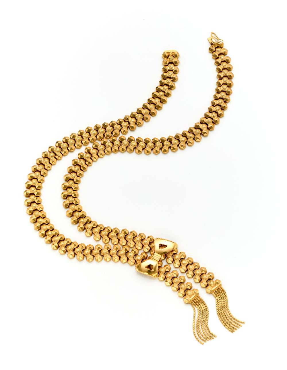 FOB Yellow gold necklace with a central pendant held by a bow and finished with tassels, g 44.55 circa, length cm 45 circa. Signed and marked Fob, 3 VI. (slight defects)...