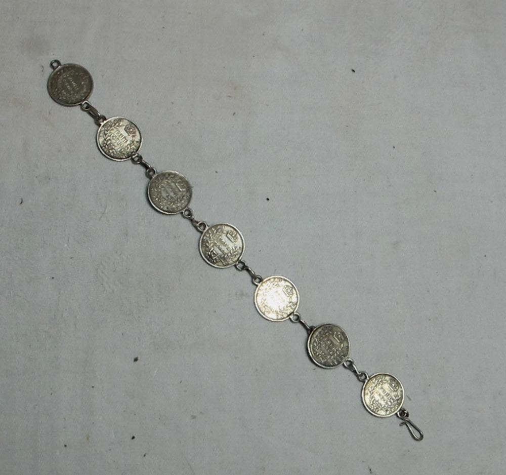 Lot 121: 1943 NEW GUINEA 4 PENCE SILVER COIN 7 LINK BRACELET