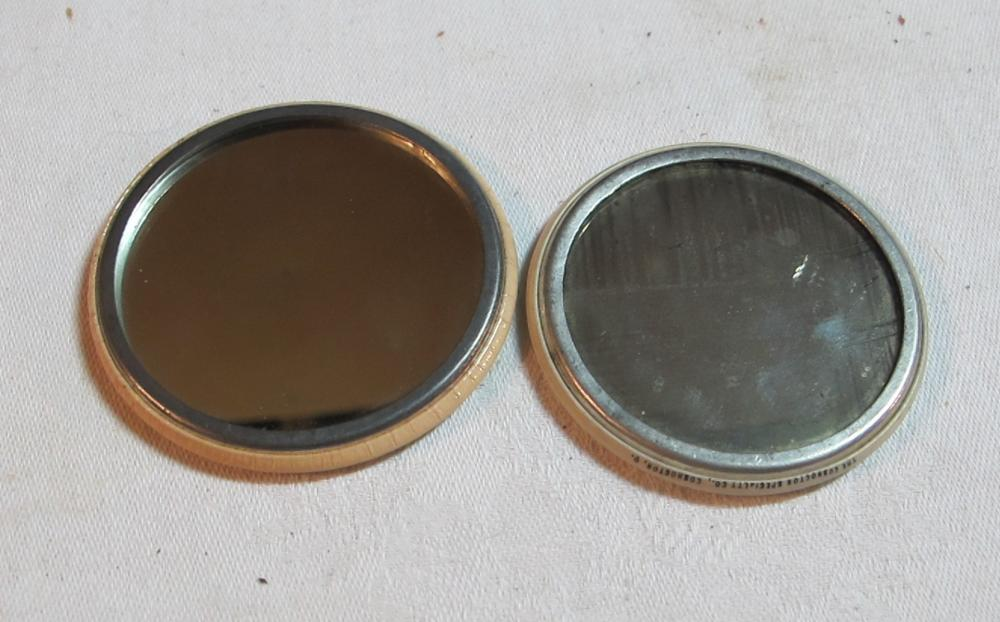2 OLD ADVERTISING CELLULOID POCKET MIRRORS 1901 OMAHA STREET FAIR STAR CLOTHING CO YAKIMA WA
