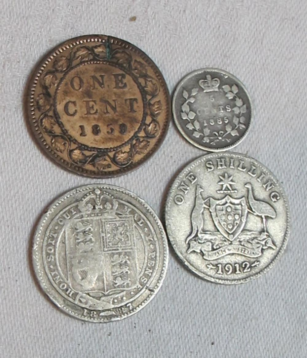 Lot 180: 4 OLD SILVER COINS 1885 CANADA 5 CENTS 1859 LARGE CENT 1912 AUSTRALIA SHILLING ETC