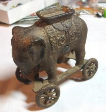 Lot 39: ANTIQUE AC WILLIAMS CAST IRON ELEPHANT ON WHEELS STILL BANK ORIGINAL PAINT