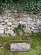 An antique stone garden roller