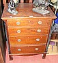 A mahogany chest of four long graduated drawers
