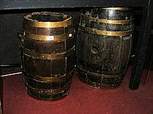 Two brass bound converted rum barrels