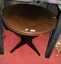 A 60cm diameter Bakelite low occasional table