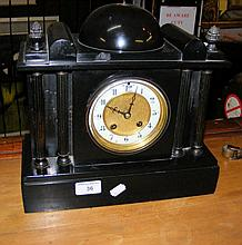 A slate cased striking mantel clock of Palladian