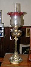 A brass column oil lamp with glass reservoir,
