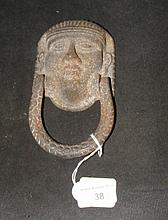 Cast metal door knocker of Egyptian head