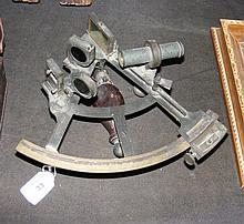 An antique sextant with turned wooden handle, the