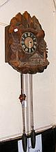 An antique carved pine cuckoo clock, having two
