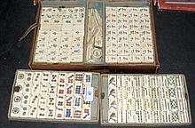 An old Mah-Jong set, having four fitted trays and
