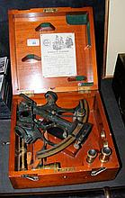An antique sextant, having triple ring frame and