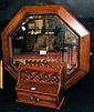 An oak framed octagonal bevelled wall mirror and a
