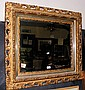 A decorative antique wall mirror with pierced gilt