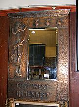 An Art Nouveau hammered copper framed Scottish