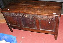 Small oak coffer with carved frieze to the triple
