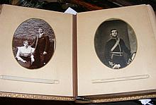 An early metal bound family photo album containing