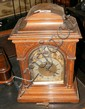 An oak cased chiming bracket clock with silvered