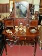 A 19th century mahogany dressing table with bow