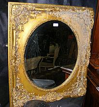 Decorative gilt framed wall mirror