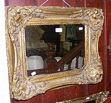Decoratively gilt framed wall mirror