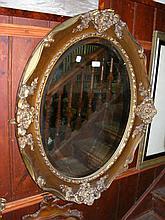 An oval bevelled gilt framed wall mirror