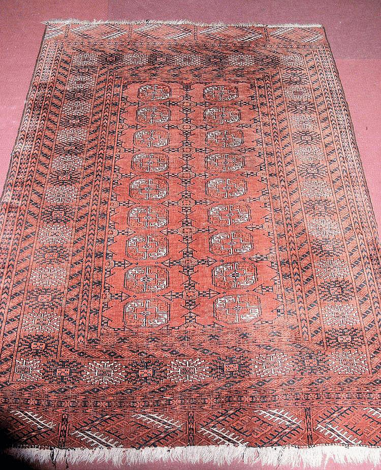 A Middle Eastern style rug with geometric border