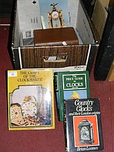 Box containing various volumes on clocks,