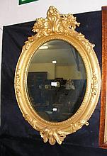 Decorative gilt framed oval wall mirror