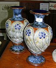 A pair of 34cm high Royal Doulton stoneware vases