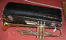 A brass trumpet stamped