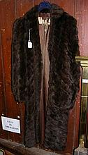 A lady's full length fur coat