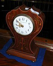 An Edwardian inlaid mahogany cased mantel clock