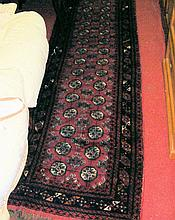 An antique Middle Eastern runner with red ground