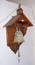 Decorative pierced brass bell in carved oak