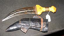 An old yellow metal mounted Jambiya with leather