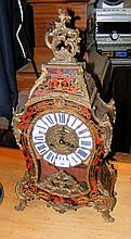 A Boulle style reproduction mantel clock in the