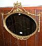 An Adams style oval wall mirror